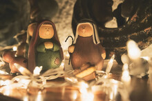 Nativity Scene On A Wooden Table With Xmas Lights
