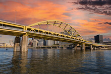 Downtown Urban Waterfront And Route 279 Bridge With Sunset Sky In Pittsburgh, Pennsylvania.