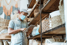 Male Business Owner Keep Working And Wear Face Masks At His Art And Craft Store