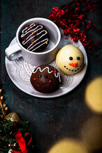 Cocoa Bomb That Melts With Hot Milk. Chocolate Bomb With Mini Marshmallows. Dark Chocolate And Cookies And Cream Flavor. Cup Of Hot Chocolate. Comfort Food. Christmas Treat. Snowman Ball.
