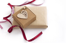 Two Boxes, Two Red Ribbons, A Carved Wooden Heart. Gift Wrapping For The New Year, Valentine's Day.