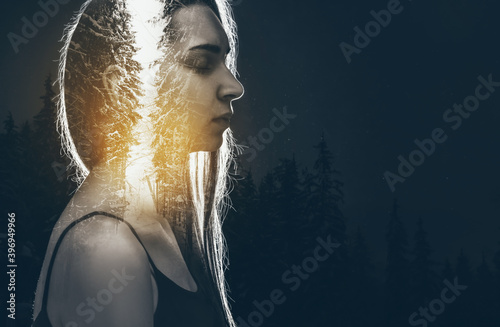 Fototapeta Double exposure of meditating woman and forest on dark background obraz