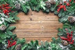 canvas print picture - Christmas and New Year background with fir branches and snowfall on wooden board