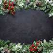 canvas print picture - Christmas and New Year background with fir branches and snowfall on dark stony board