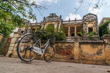 THE MANSION, PHNOM PENH, CAMBODIA - 07 February 2009: Bicycle Parked In Front Of Famous Derelict Colonial Building Owned By FCC And Called