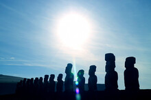 Bright Sun Raising Over The Silhouette Gigantic Moai Statues Of Ahu Tongariki Celemonial Platform, UNESCO World Heritage On Easter Island, Chile
