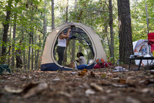 Diverse Female Friends Camping...