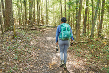 Black Woman Hiking Trail In The Woods