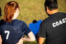 Teenage Soccer Coach Teaches Plays With Female Team