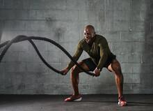 Man Doing Battle Rope Training Exercises
