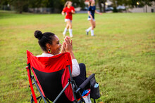 Supportive Mother Cheers For Daughters' Team