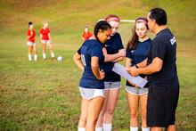 Man Coaching Girls Soccer Team