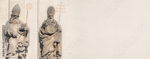 Cuadros en Lienzo Banner with ancient decorative facade statues of priests, bishops at Saint Salvator church near Charles Bridge in Prague, Czech Republic, with copy space for text, details
