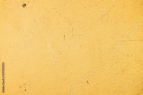Zółte jasne tło betonowo kamienne.