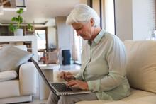 Senior Caucasian Woman Using Laptop Computer