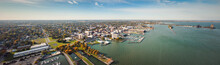 Incredible Aerial City Skyline Panorama Photograph Of Sandusky, Ohio From The Shoreline Of The Bay In Lake Erie With Parks And Harbors Seen Below On A Sunny Day.