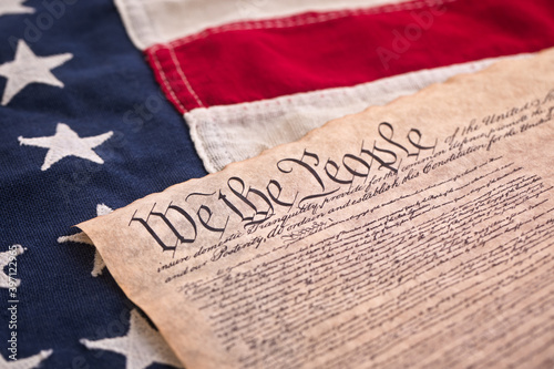 Copy of the US Constitution on a vintage American Flag