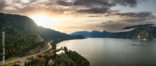 Sea to Sky Hwy in Howe Sound near Squamish, British Columbia, Canada. Aerial panoramic View. Beautiful Sunny and Cloudy Morning Sky Art Render.