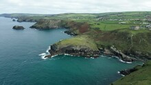 Scenic View Of Camelot Castle Hotel And Barras Head From Tintagel Castle In Cornwall, England - Aerial Drone