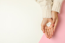 Female Hands With Heart Shaped Cream On Two Tone Background