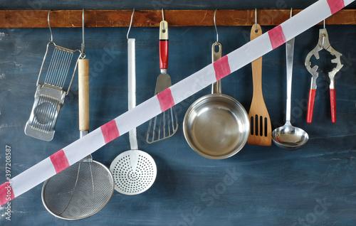 Canvas Print gastronomy corona lockdown, restaurant kitchen utensils with warning tape,symbol
