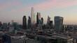 Cinematic slider aerial drone shot of City of London skyscraper buildings beautiful sunrise