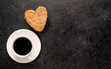 Festive Breakfast For Valentine's Day. Coffee And Heart Shaped Cake On A Stone Background With Copy Space For Your Text