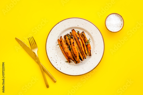 Fototapeta Top view of sweet potato fries with herbs and spices obraz