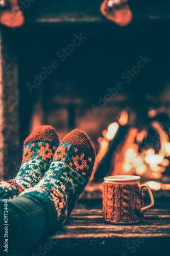 Canvas Print Feet in woollen socks by the Christmas fireplace