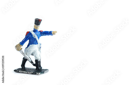 Fototapeta Photo of handmade metal soldier's figurine on the white background