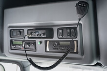CB Radio And Car Stereo In The Truck Cabin Close Up Background.