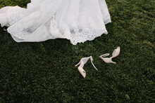 Wedding Dress And Shoes On Grass