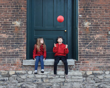 Family Kids Playing Outside With Red Ball
