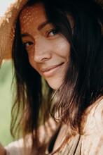 Portrait Of Beautiful Asian Woman In Straw Hat