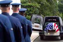 Soldiers Watching Casket At Military Funeral