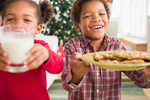 Black Children With Milk And Cookies For Santa Claus