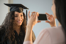 Mother Photographing Daughter At Graduation