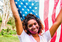 Mixed Race Woman Covered In Pigment Powder Holding American Flag
