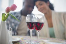 Couple With Red Wine In Restau...
