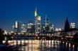 Illuminated riverfront skyline