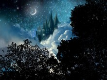 The Silhouette Of European Beautiful Castle And The Crescent Moon Behind Deep Forest In Starry Night Sky Background