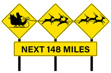 Santa Crossing Sign With Sleigh And Reindeers Silhouette. 3 Yellow Highway Traffic Alert Signs On Poles On Top Of A Miles Sign. Concept For Christmas, Xmas, Santa's Flight Path.