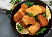 Crispy Chicken Nuggets On Grey Background.