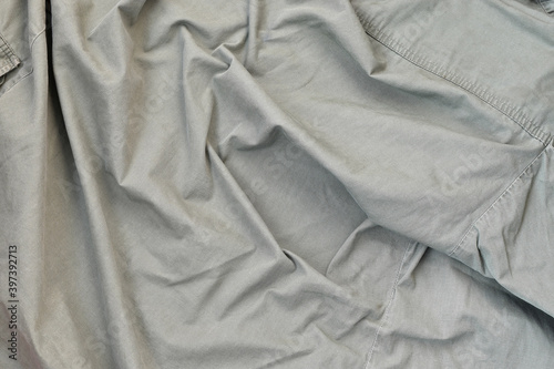 Fototapeta The texture of the fabric is olive-colored, which is similar to the uniform of A