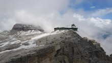 Reverse Aerial Of Piz Boe Mountain Summit Cross And Cable Car, Dolomites Italy