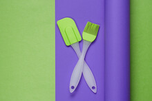 Kitchen Tools On A Colored Wrapped Paper Background. Minimalistic Cooking Still Life. Pastel Color Trend