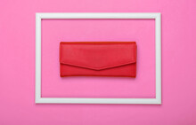 Red Wallet In A White Frame On Pink Background. Top View