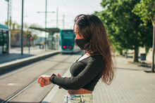 A Woman Wearing A Black Protective Face Mask.