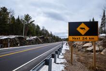 Moose Crossing Sign Warns Of Hazard For Next 24 Km