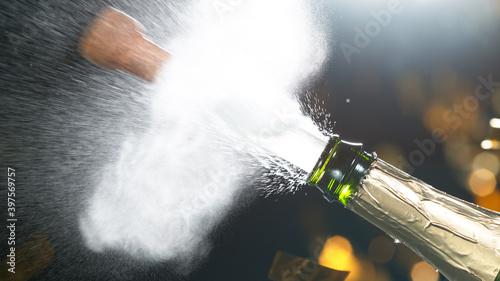 Obraz na plátně Champagne explosion with flying cork closure, opening champagne bottle closeup, celebration theme